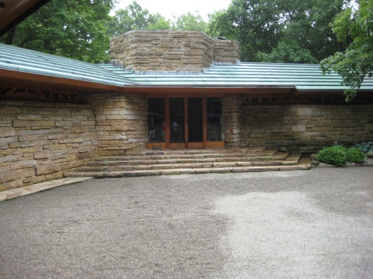 The entrance to Kentuck Knob. The orange tile to the right of the door is Wright's signature, a practice he started late in his career. Our guide said he didn't leave a similar signature at Fallingwater.