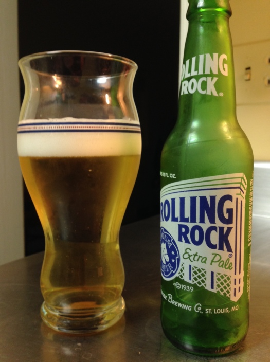Rolling Rock Extra Pale, Anheuser‑Busch InBev. American adjunct lager, 4.5 percent alcohol by volume. I was a regular Rolling Rock drinker for a year or two way back in the day, well before the brand was purchased by A-B and production was moved to the glass-lined tanks of old New Jersey. And here's the interesting thing: Rolling Rock is actually better now than I remember. Rolling Rock didn't have the same sweetness as many of the other beers I regularly grabbed in those days; in fact, it the green bottles gave up enough to the sun that it wasn't unusual to some across some skunky flavors pretty consistently. Now? No skunky, but also no cloying sweet like its counterparts.